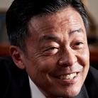 Auditor Shuhei Nozaki-Ken Mitsuishi.jpg